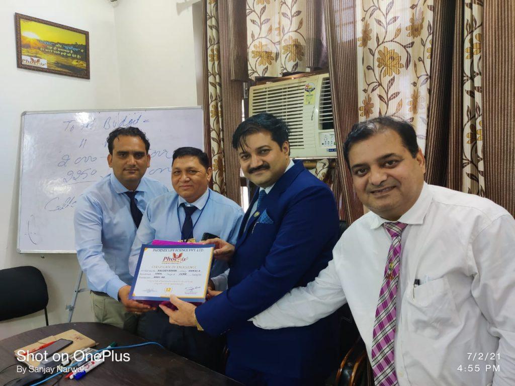Baldev Singh (Ambala) Awarded by FM Mahesh and managing director Sanjay narwal - Phoenix life science Pvt ltd