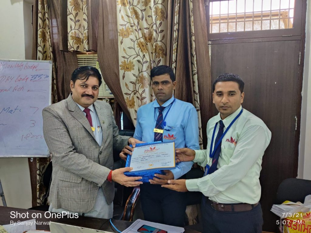 Shankar lal - Chomu - awarded by Field Manager Karan Shekhawat and Managing Director Sanjay Narwal - Phoenix life science pvt ltd
