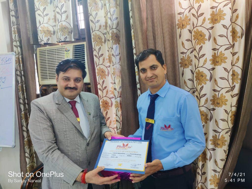 Vinod Sharma Appreciated by Managing Director Sanjay Narwal and Shashi Shekhar Upadhyay - Phoenix life Science June Month