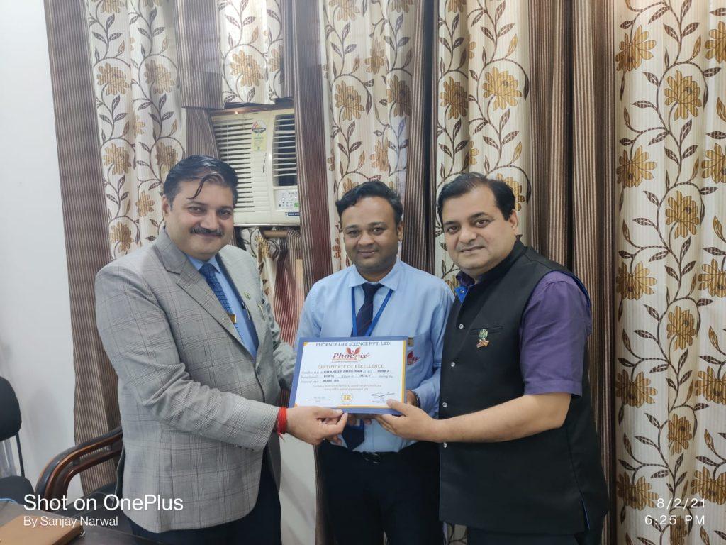 Chander Shekhar Joshi awarded by Dr. Sanjay Narwal, managing Director phoenix Life Science Pvt. Ltd. and Country head Shashi Shekhar Upadhyay