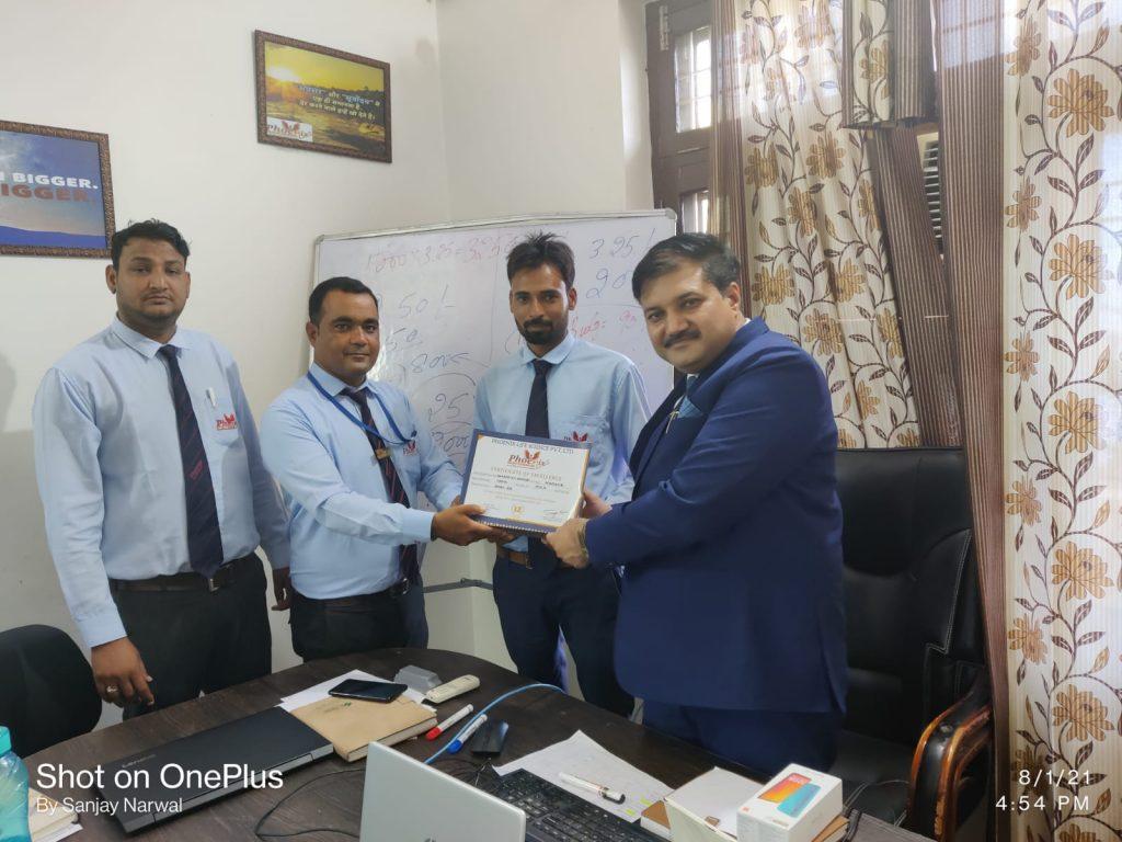"Mahipal Singh awarded by Manager Rakesh Bhakal, RSM Yogesh Sharma and ""Dr. Sanjay Narwal"" MD Phoenix Life Science"