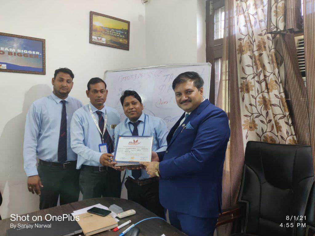 Naresh kumar Chirawa awarded by RSM Yogesh Sharma at July Monthly Meeting