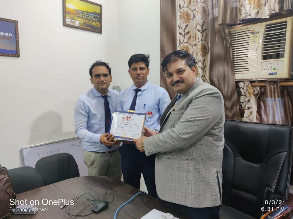 Shakti Singh taking gift from Fm mahesh Sharma and Dr. Sanjay Narwal MD